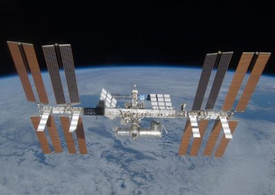 Visits the Space Station